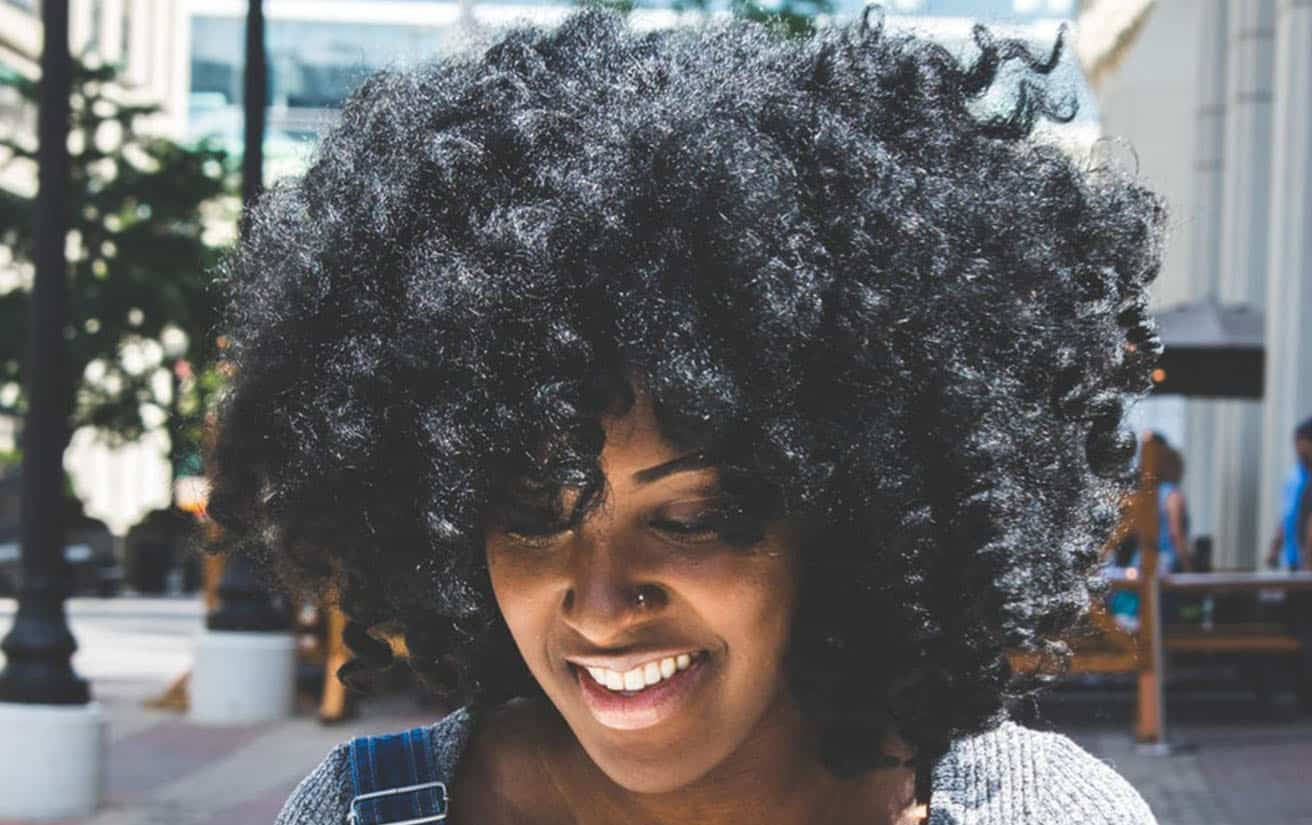 Black woman with thick, curly natural hair