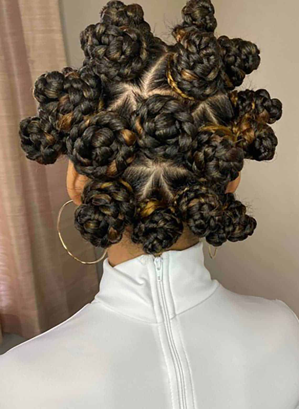 person with bantu knots