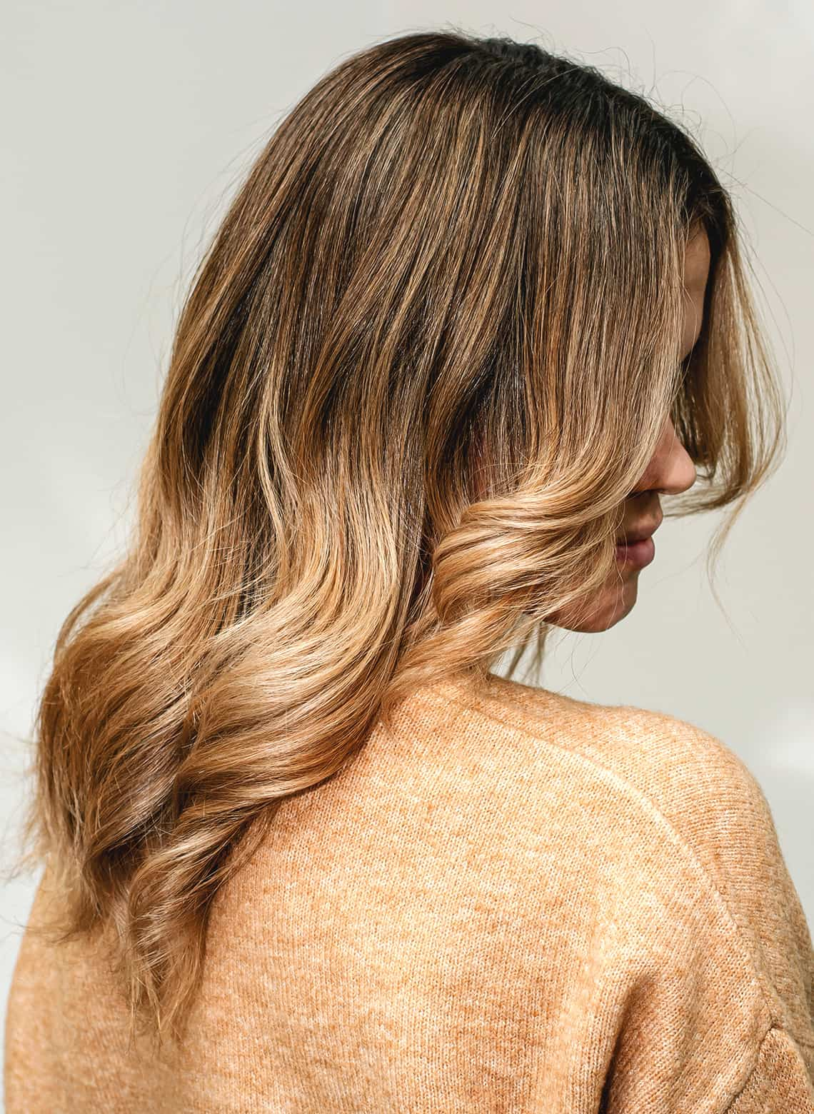 woman with blond melted balayage