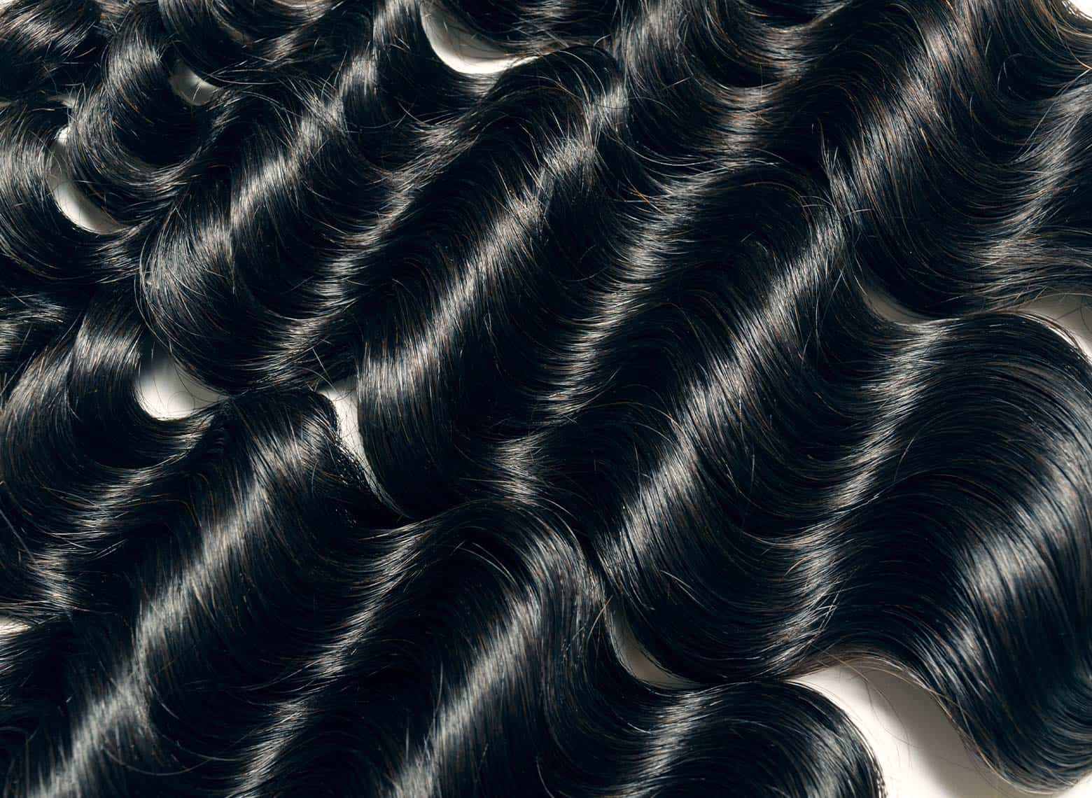 close up of weave hair laid out on table