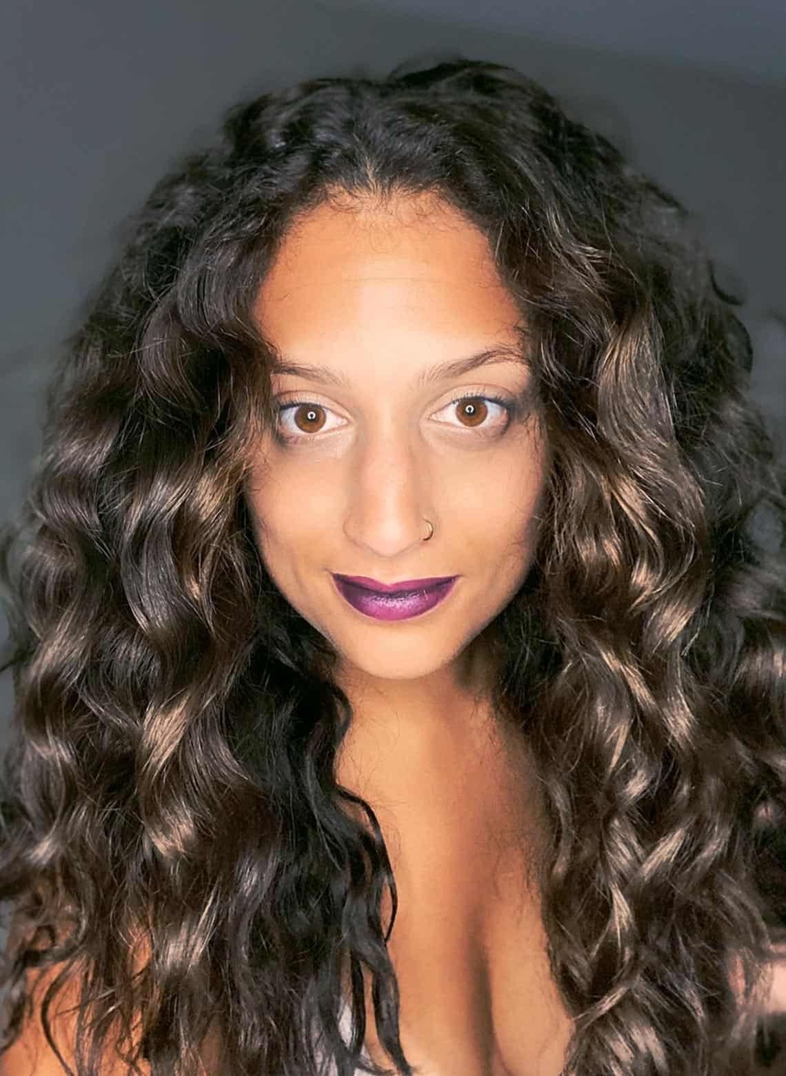 woman with middle part and loose curls