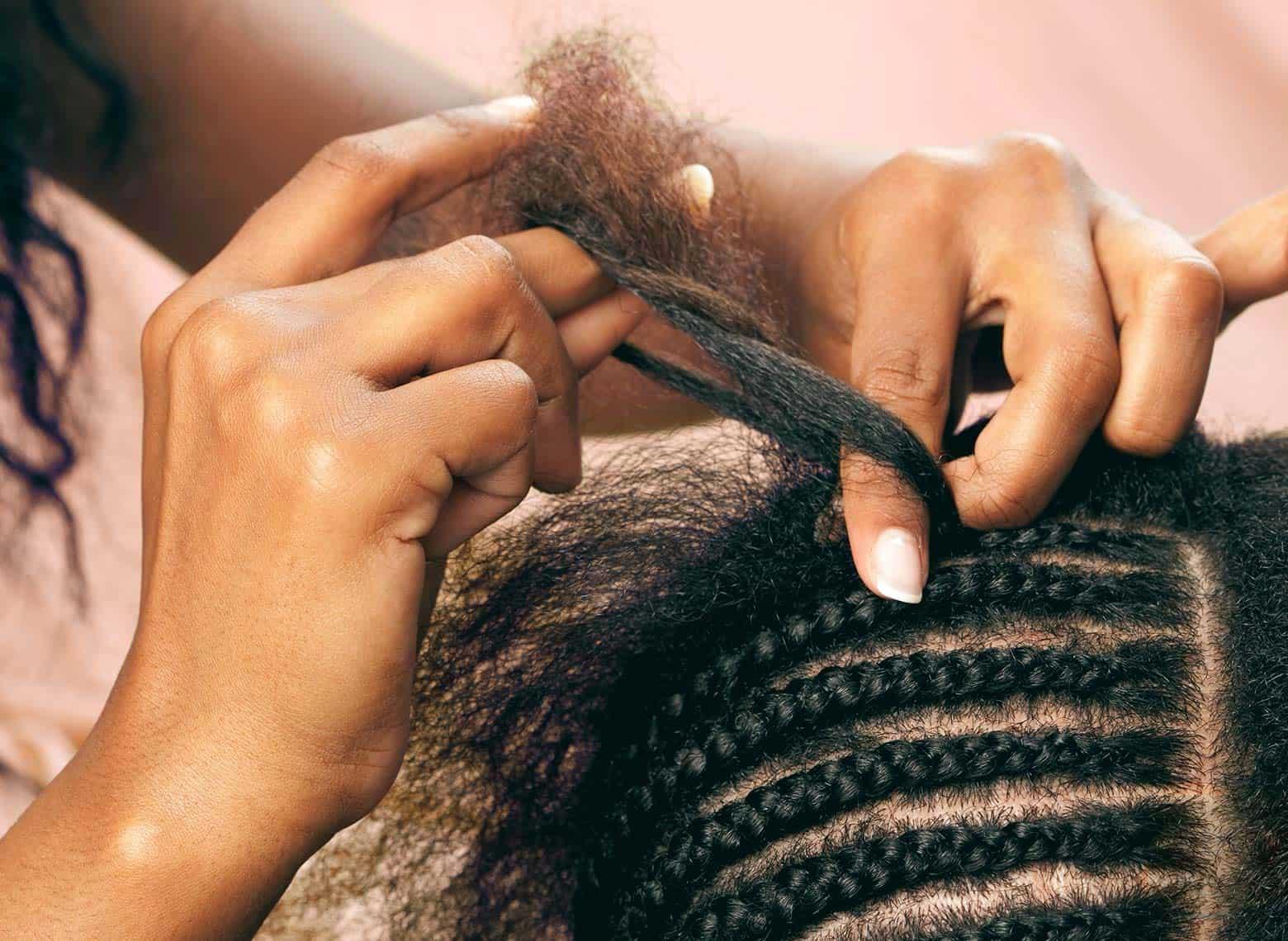 woman installing braids