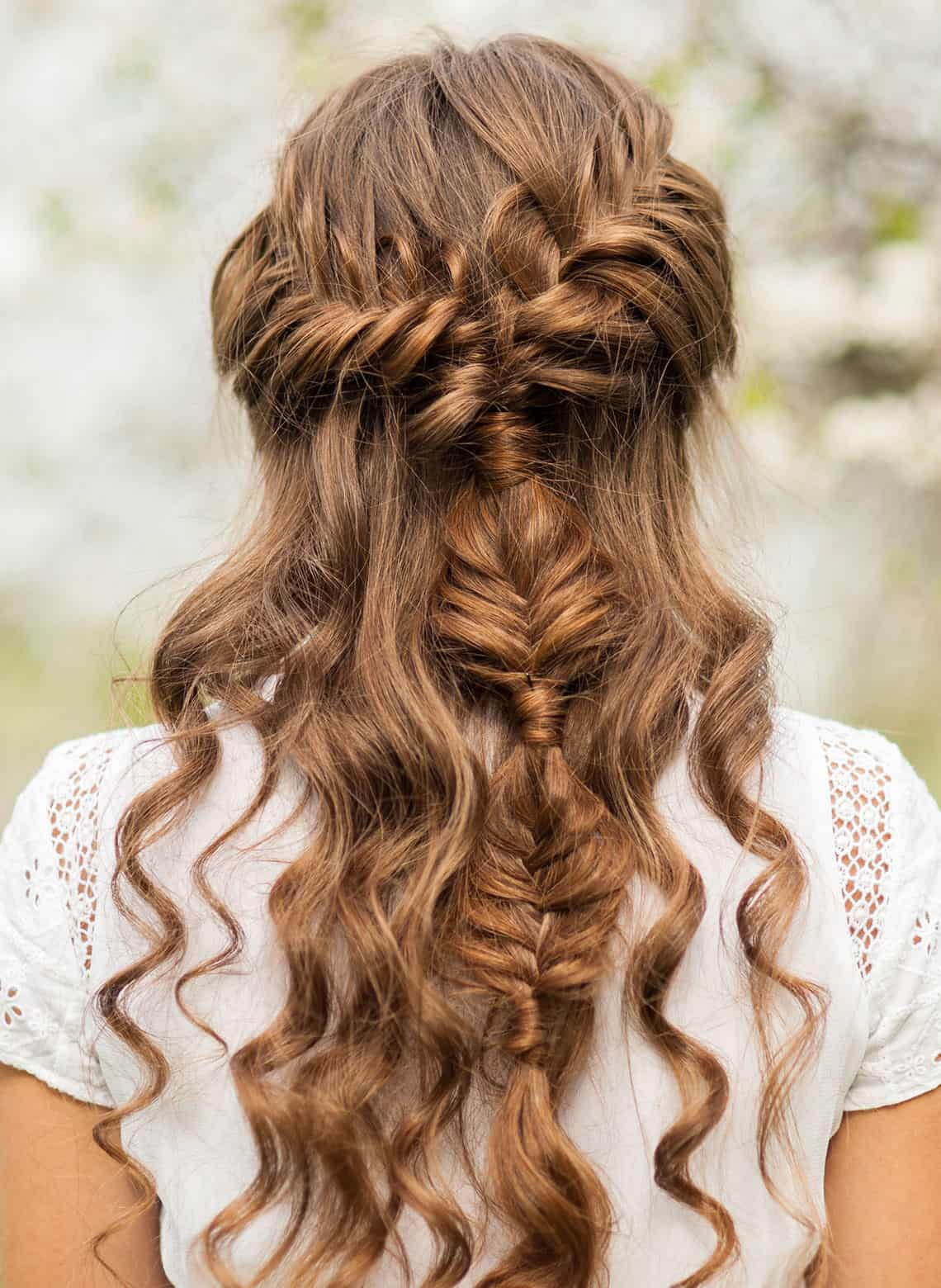 woman with half up half down curls