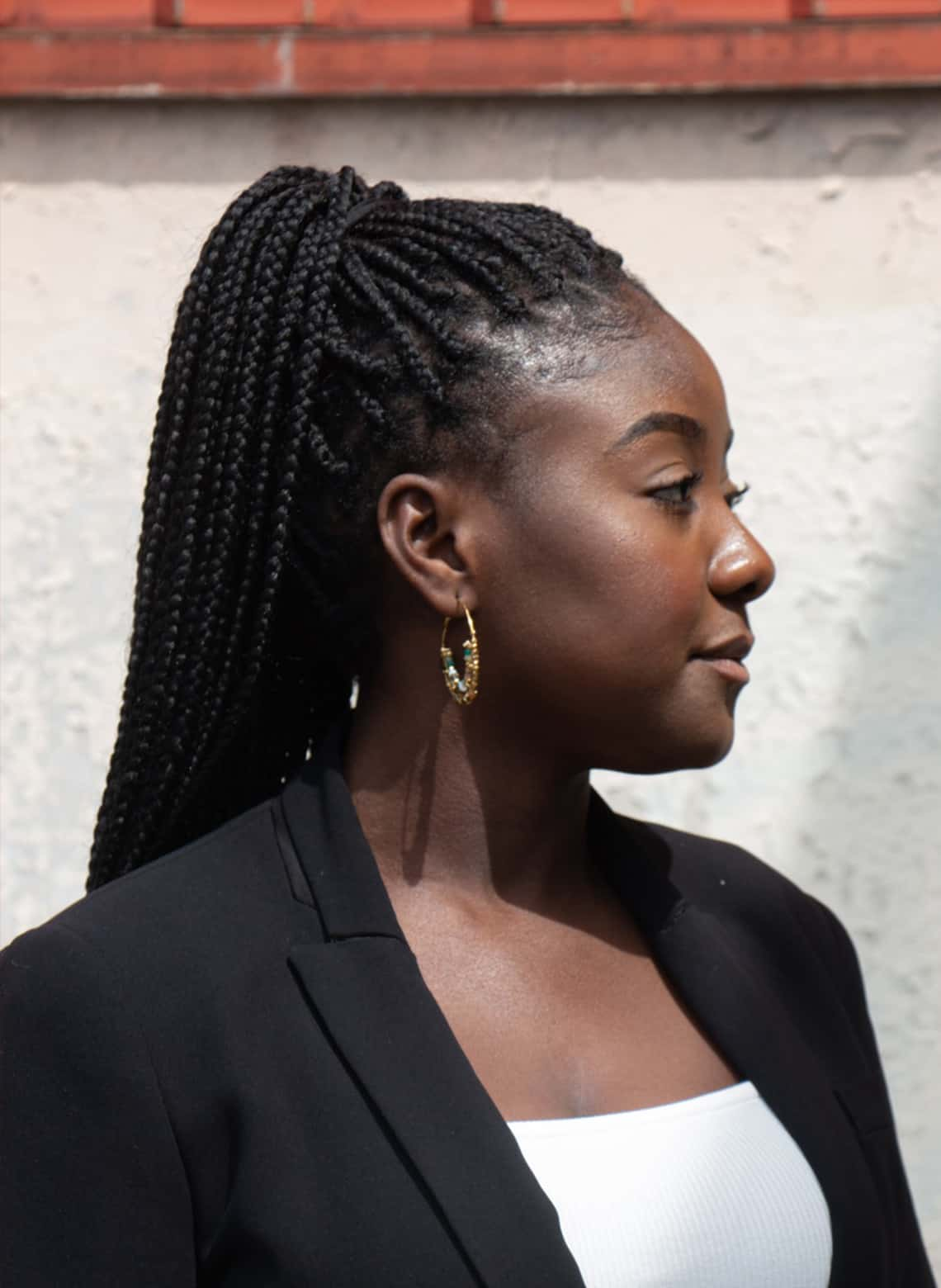 woman with small box braids and high ponytail