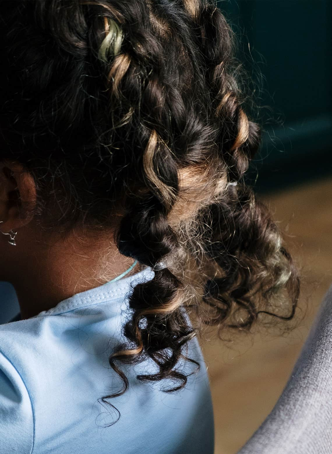 woman with curly pigtail braids