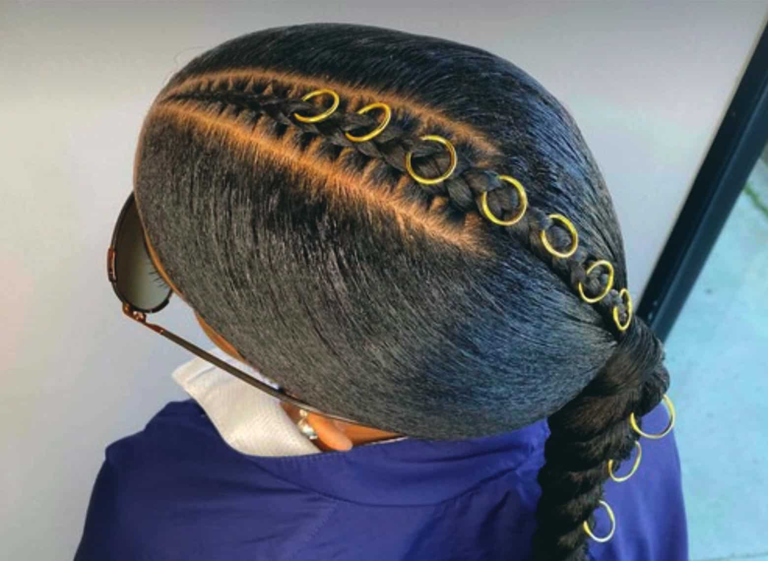 woman with middle-part braid with twisted ponytail