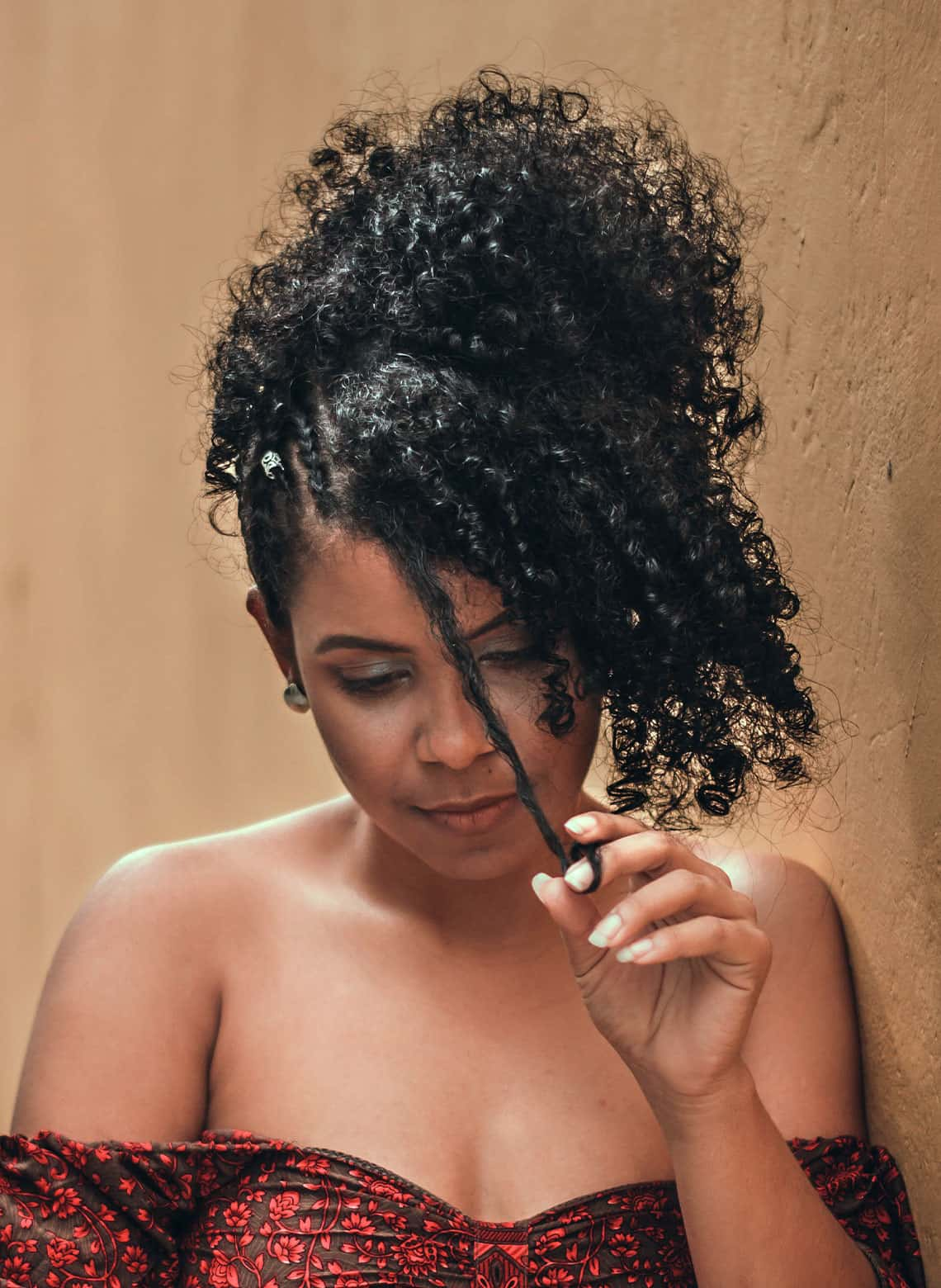 woman with braided curly pineapple