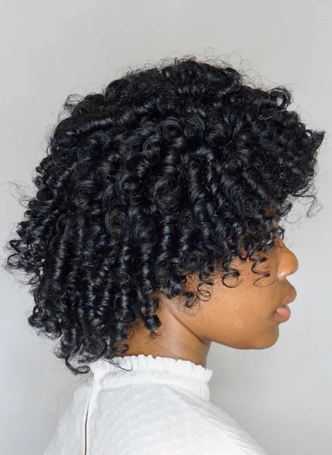woman with stacked curly bob