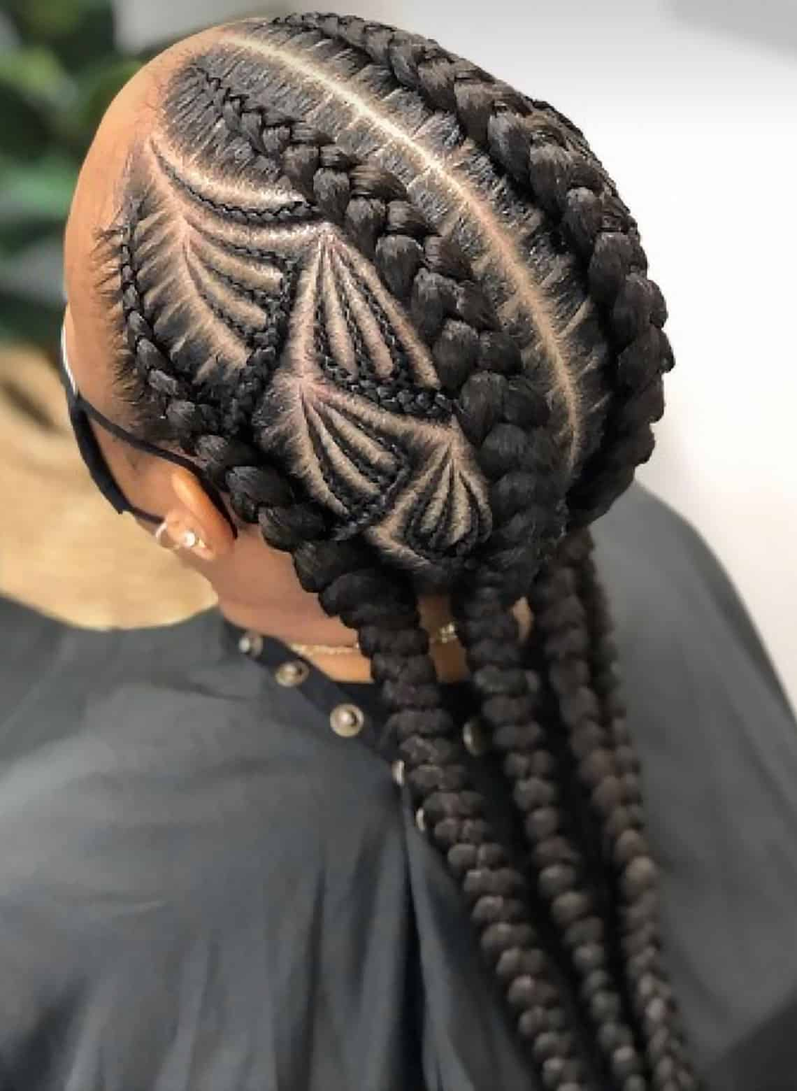 woman with chunky cornrows and design