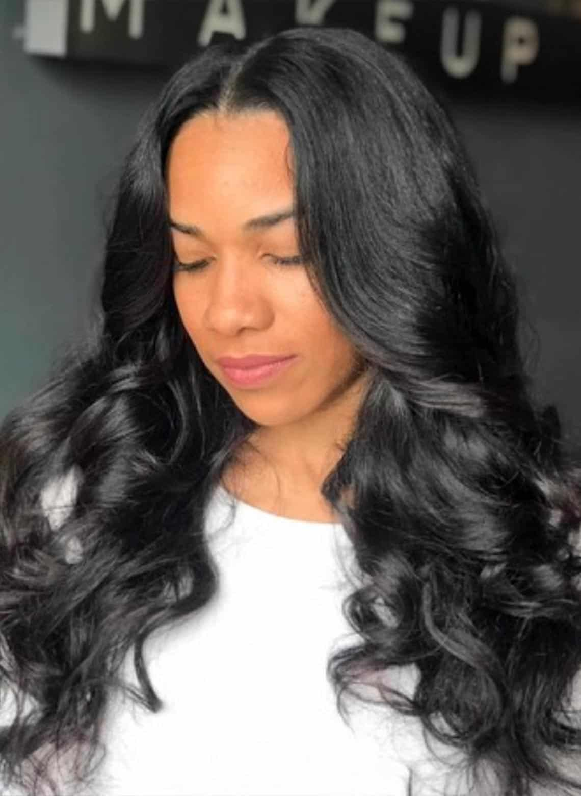 long and loose curls with curtain bangs