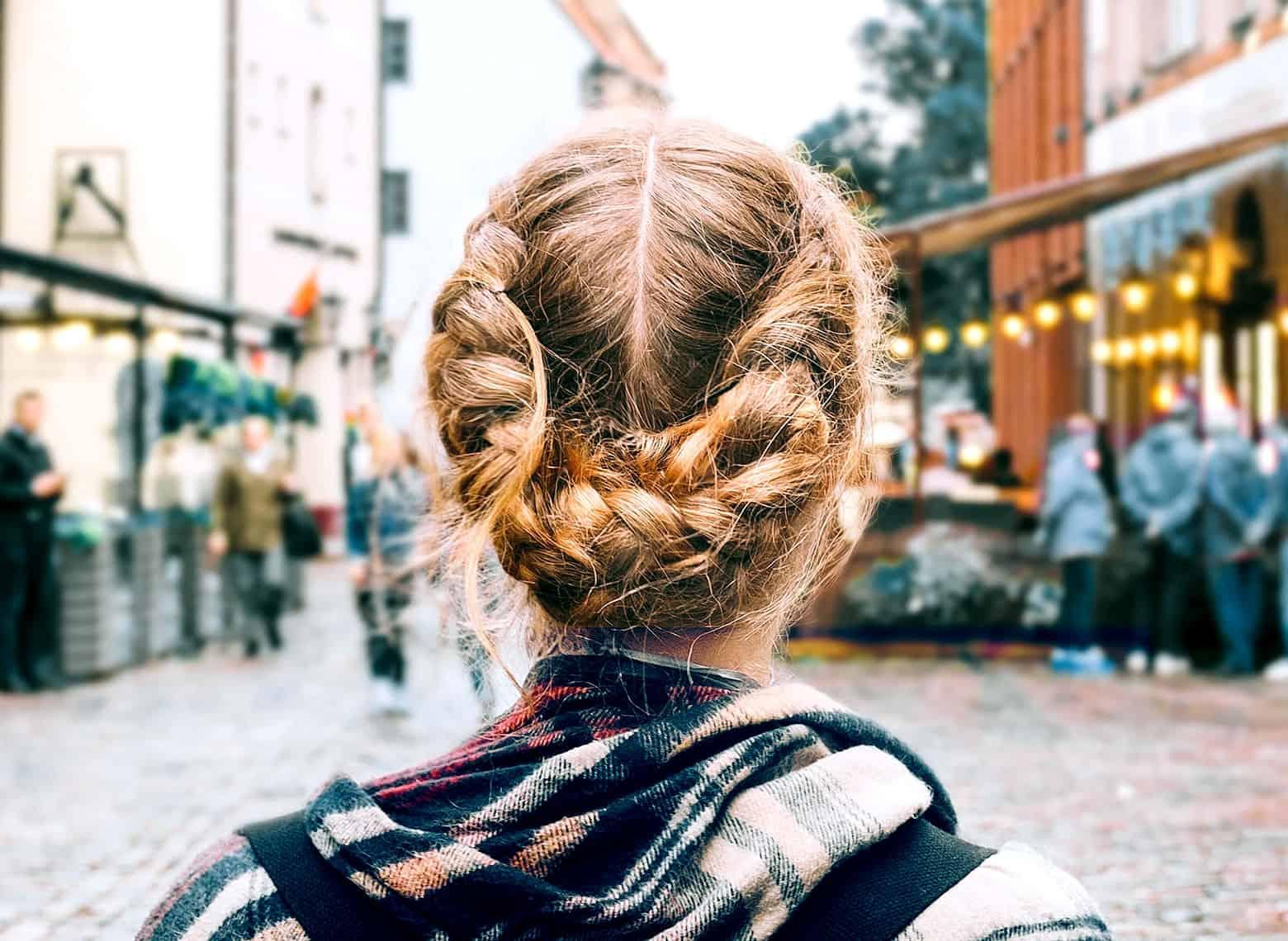 woman with dutch braided buns