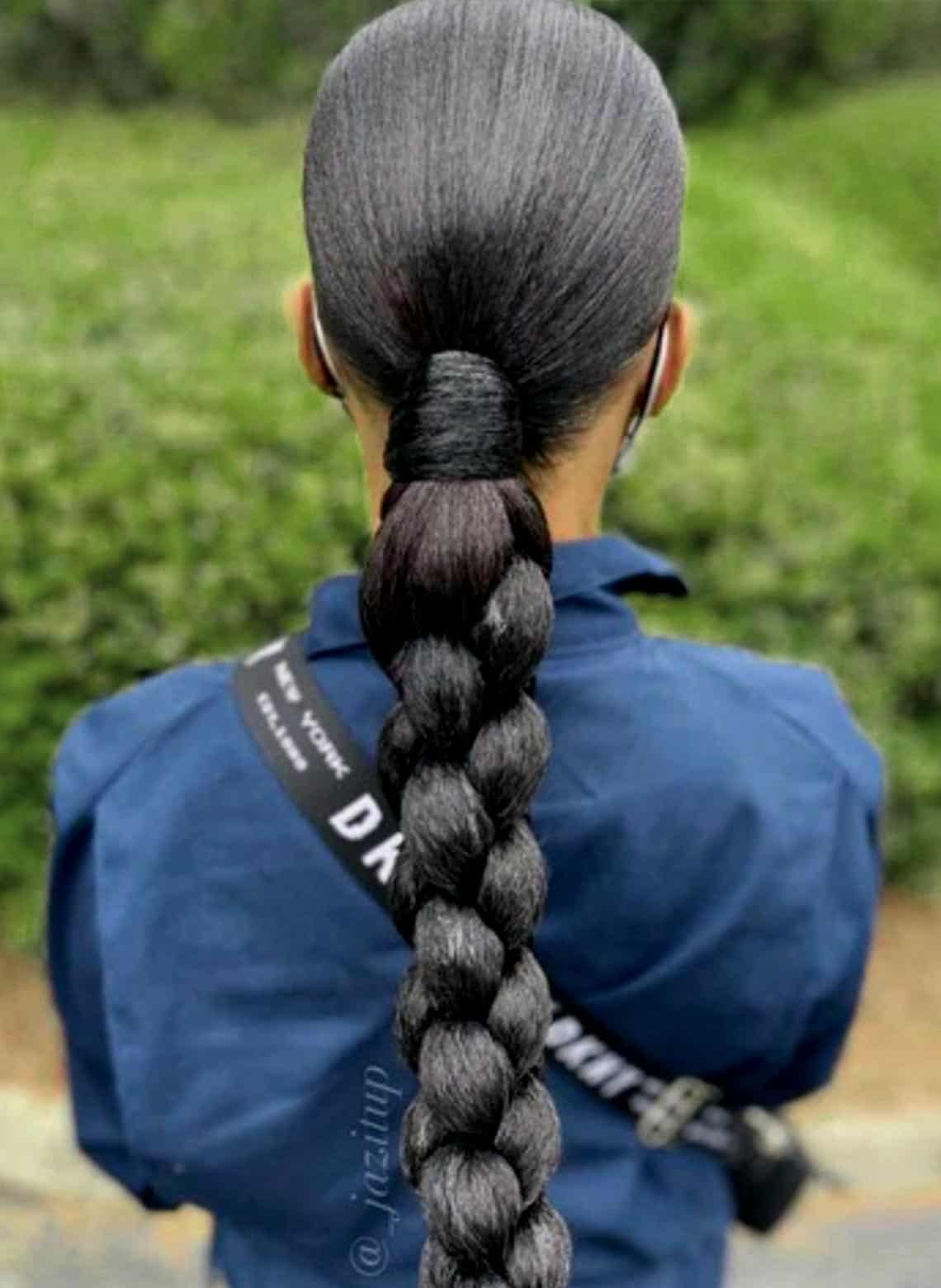 woman with slicked back and braided low ponytail