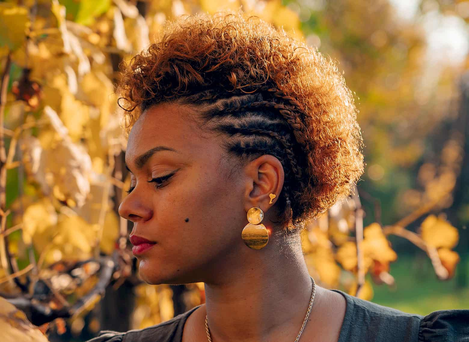woman with side cornrows and hair down