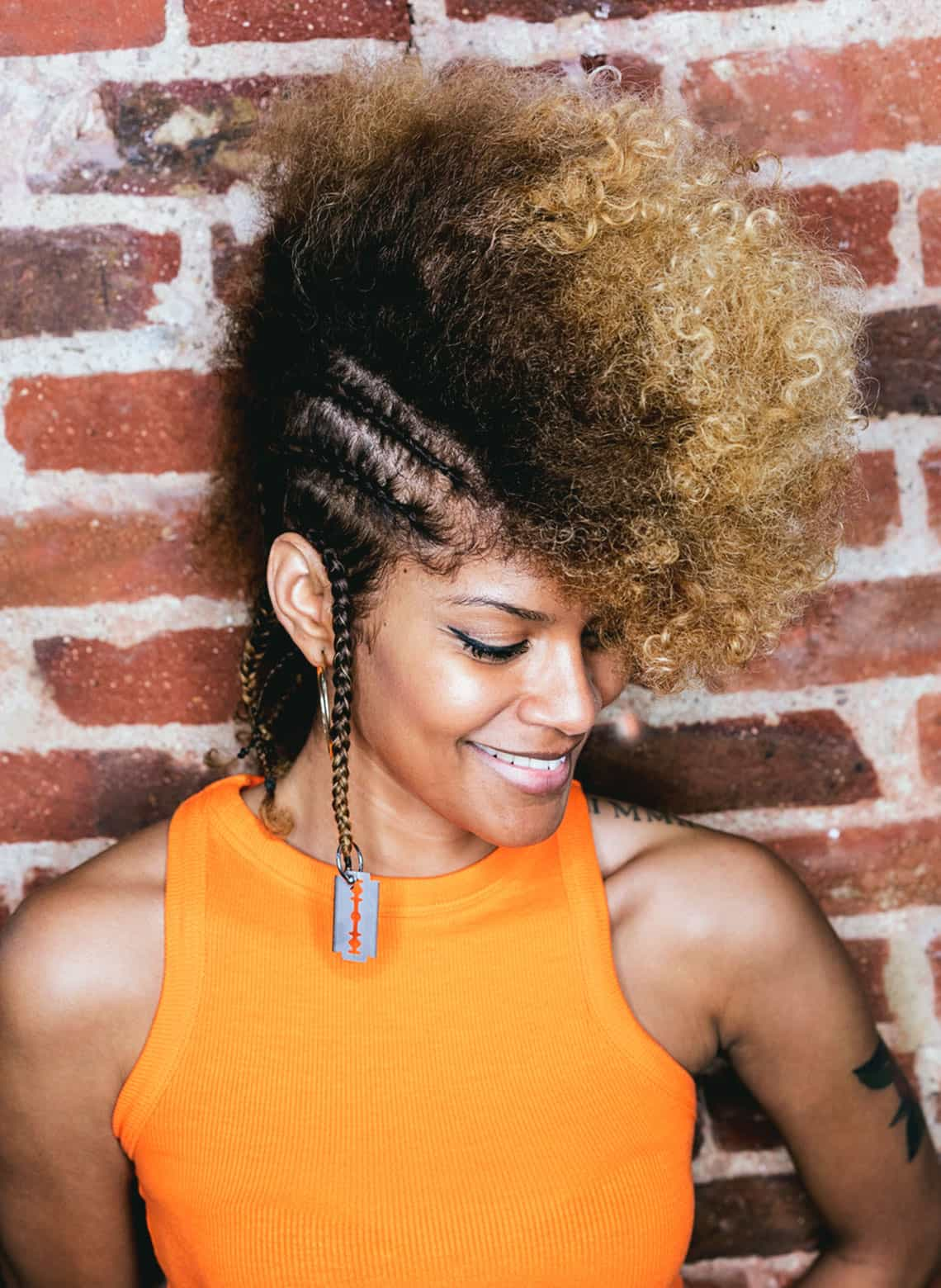 woman with braided curly mohawk