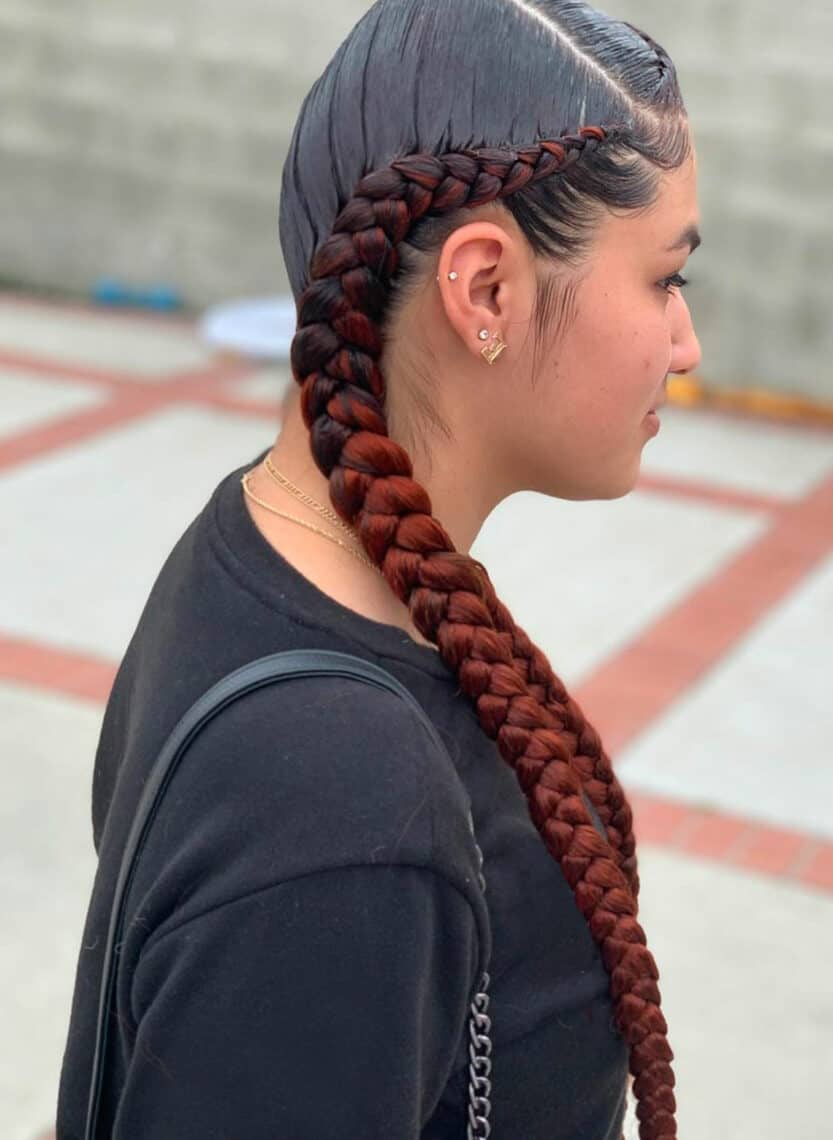 woman with colored and braided pigtails