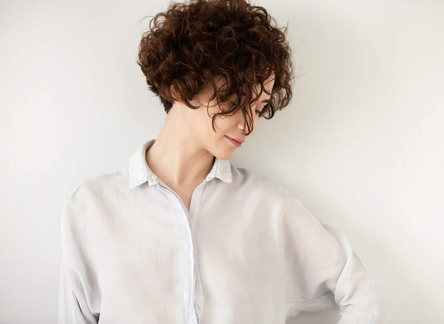 woman with short and curly hair