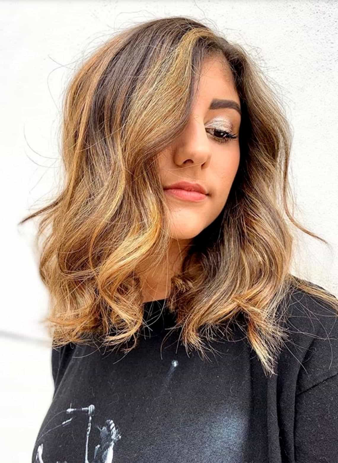 woman with highlights and loose waves