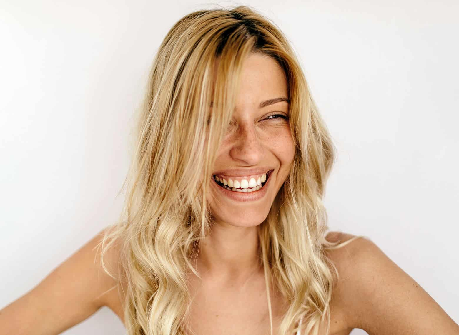 woman with blonde bed head waves