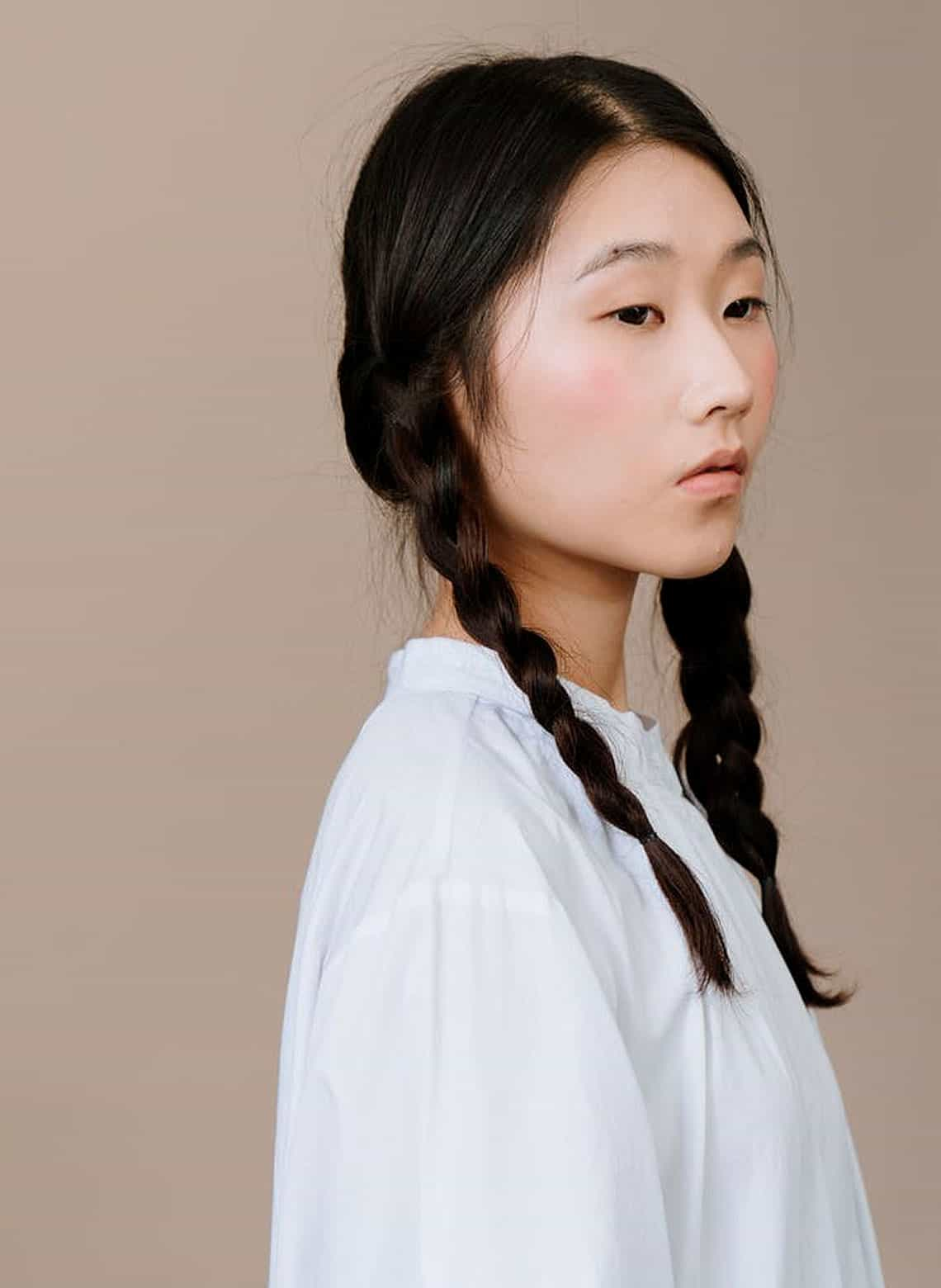 woman with classic braided pigtails