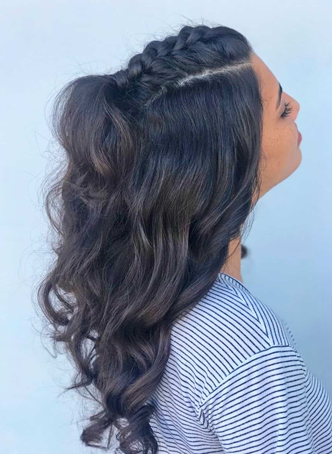 woman with half-up half down curls