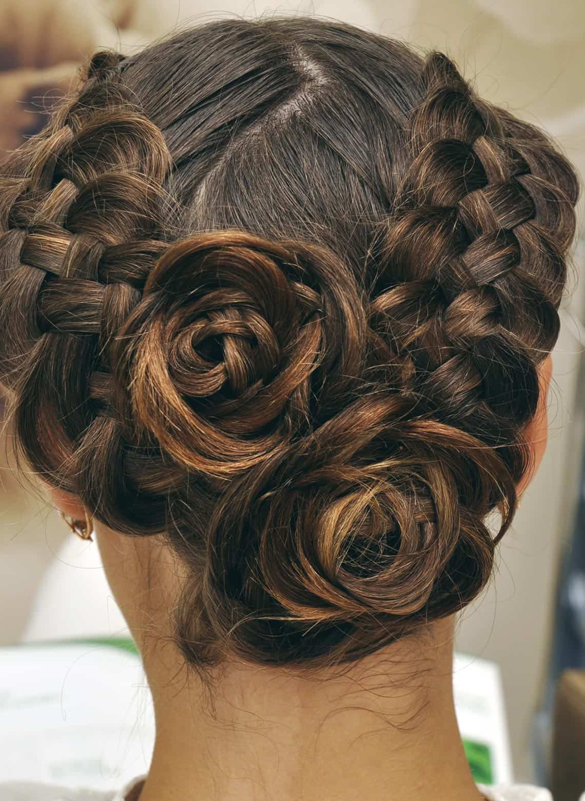 woman with braided rose updo