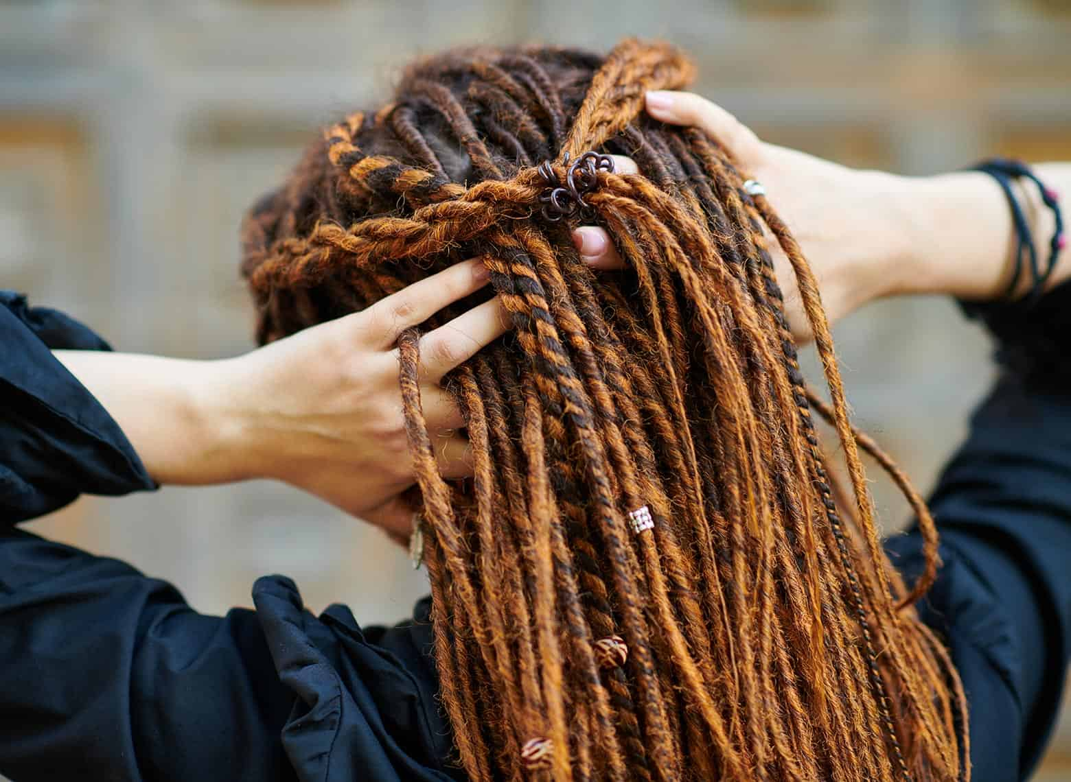 person with braided locs
