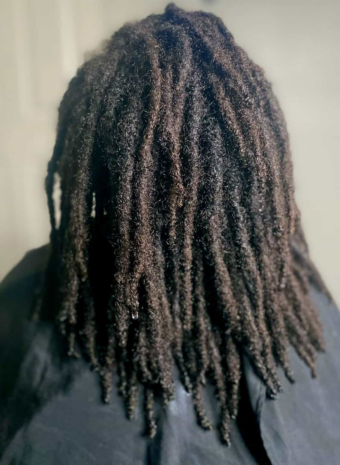 person with locs