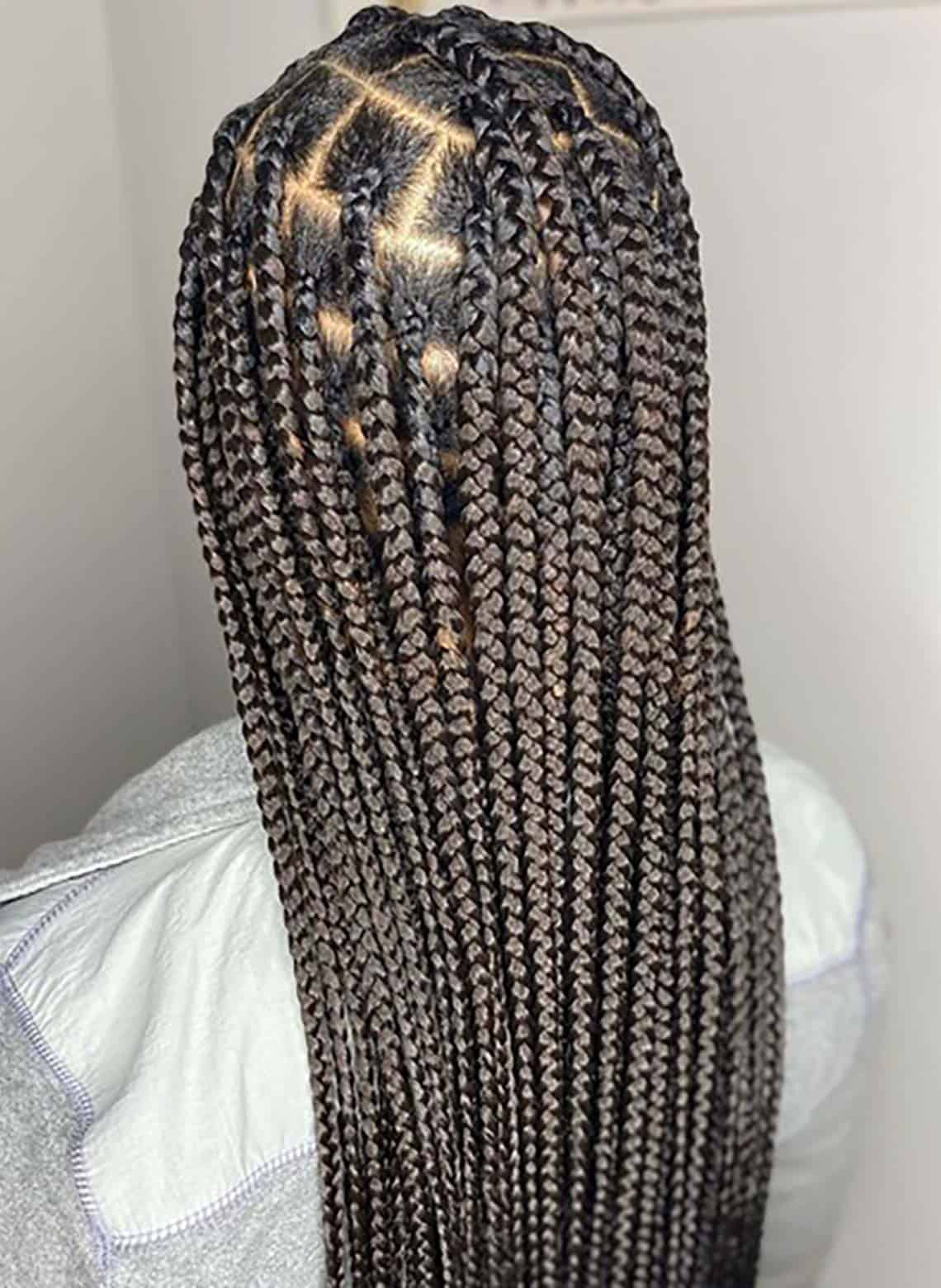 woman with long box braids