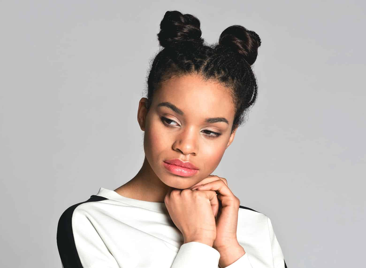 woman with braided space buns