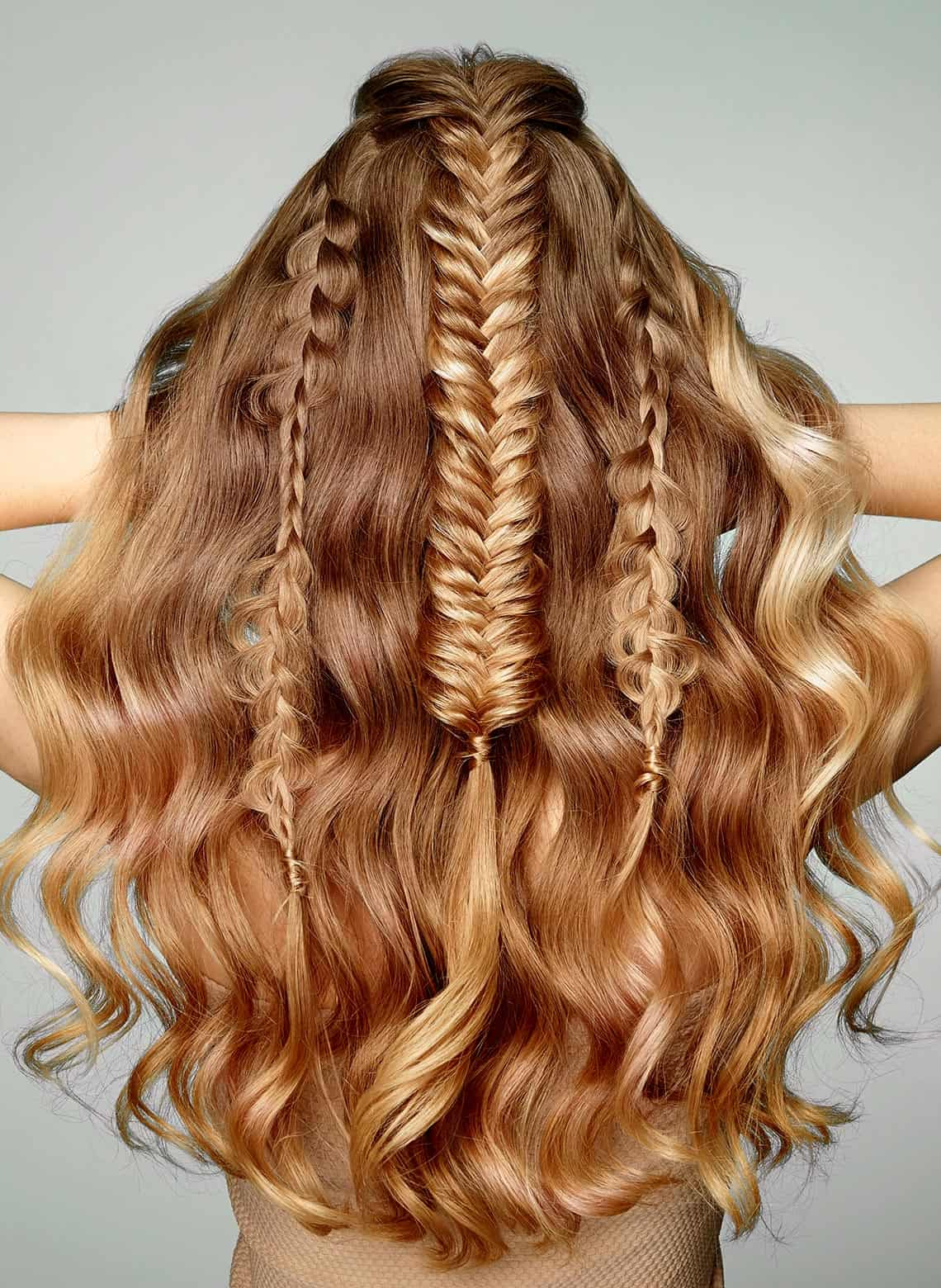 woman with fishtail braids and curls