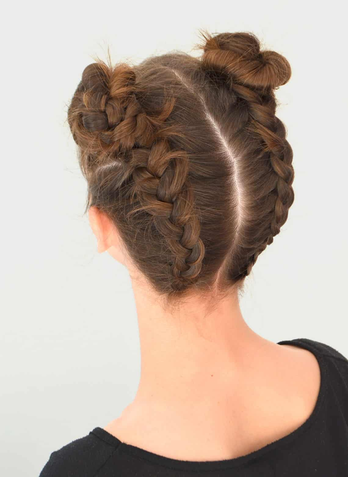 woman with french braided space buns
