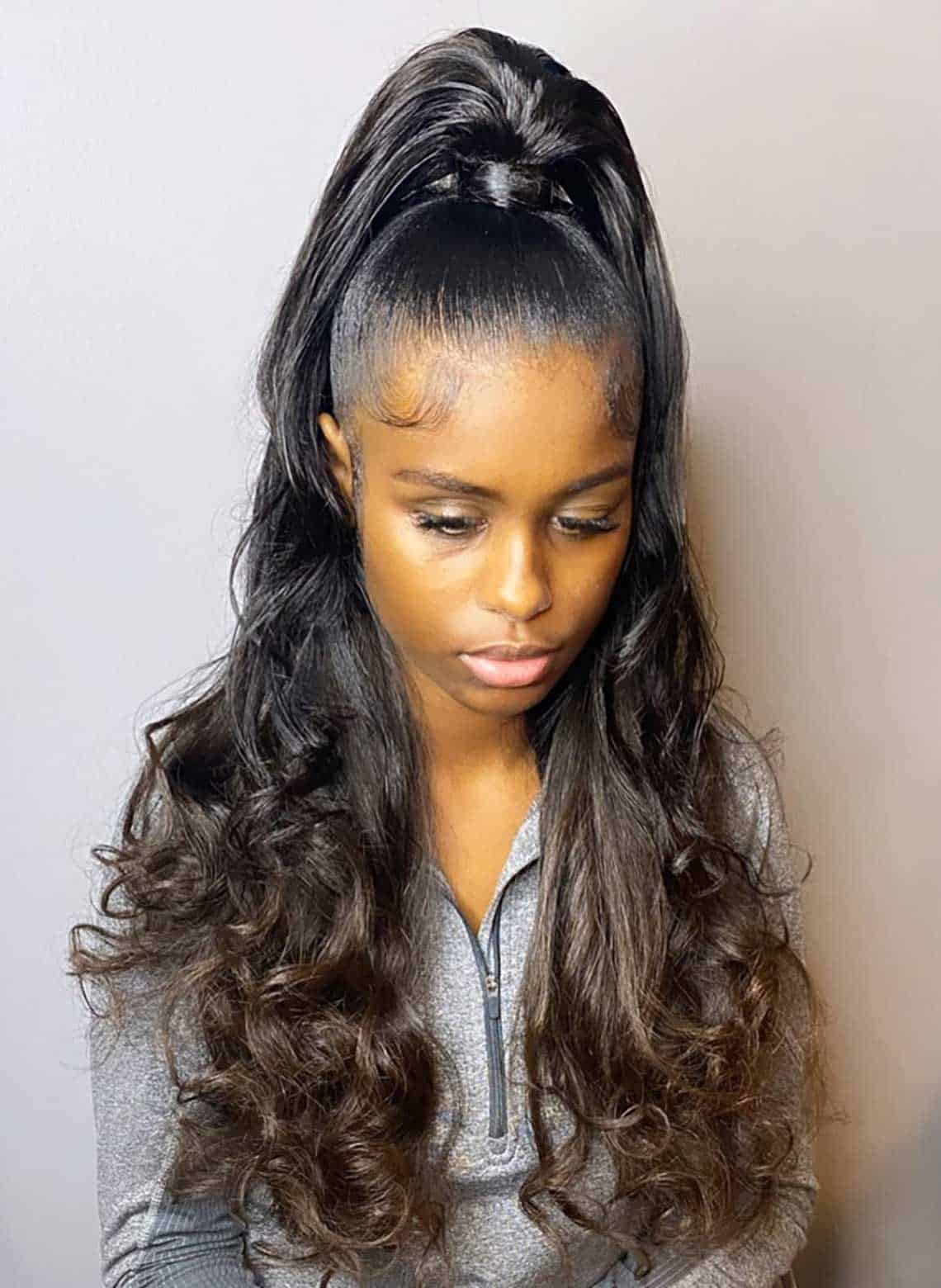 woman wit high ponytail and loose waves
