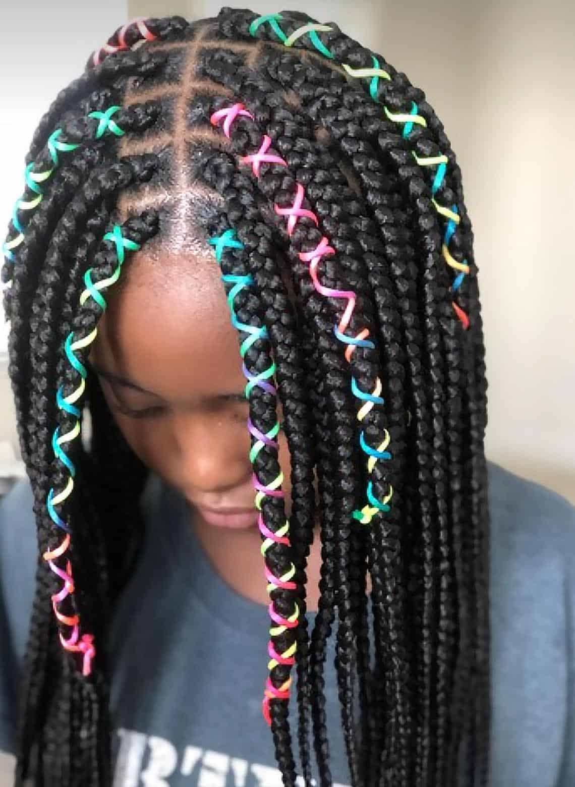 woman with braids and colorful rubber brands
