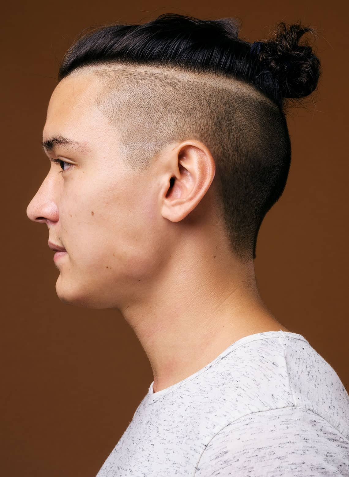 man with undercut and hard part