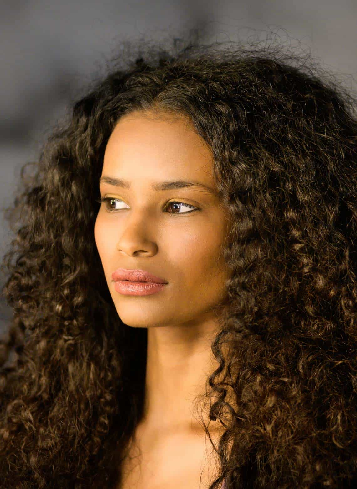 woman with brushed out curls