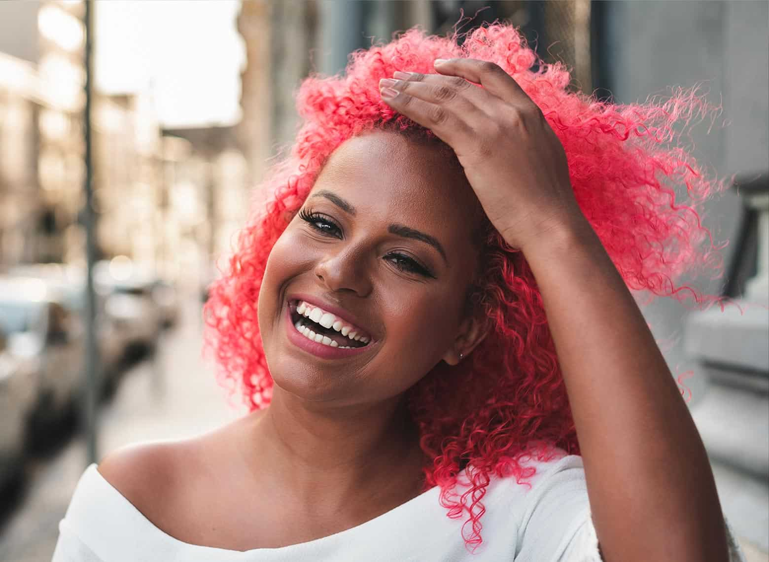 woman with bright red and curly hair