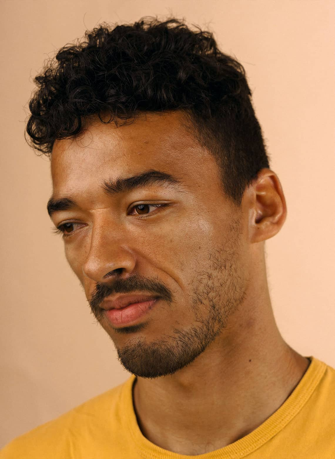 man with curly undercut