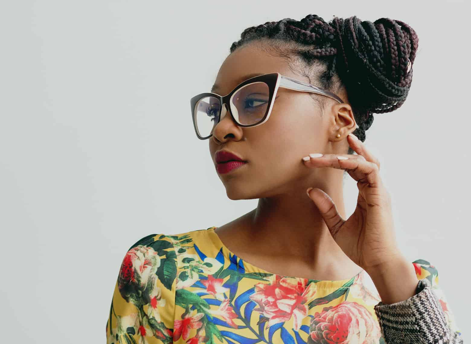 woman with box braids in a side chignon