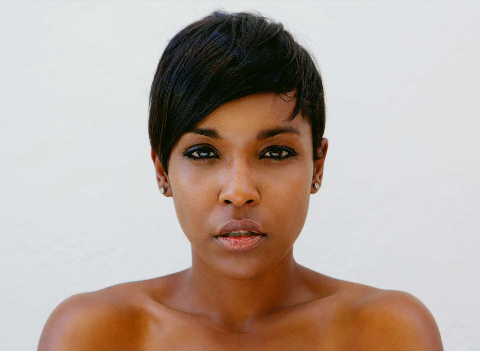 woman with pixie cut and side swept bangs