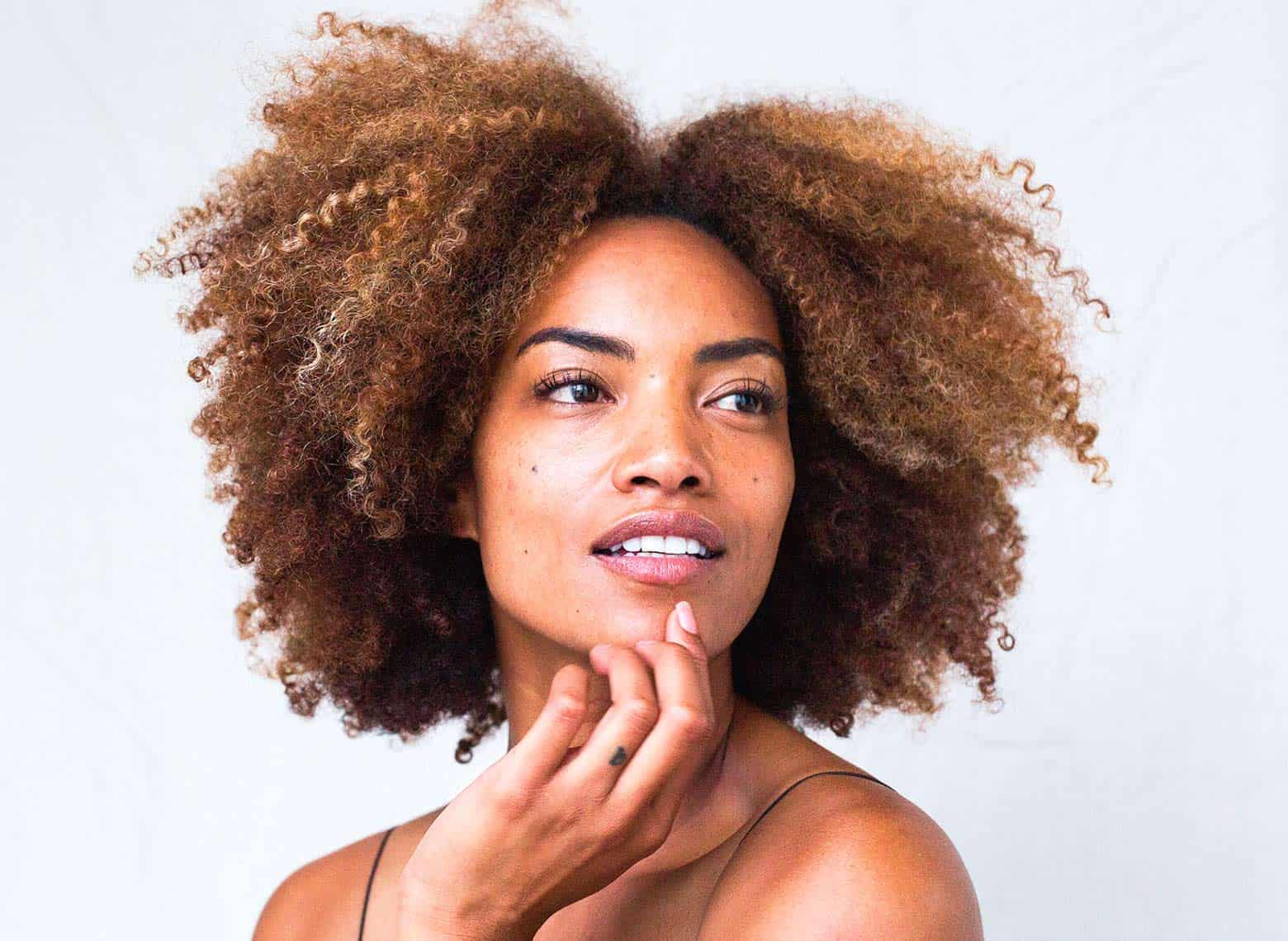 woman with brushed-out and luscious curls
