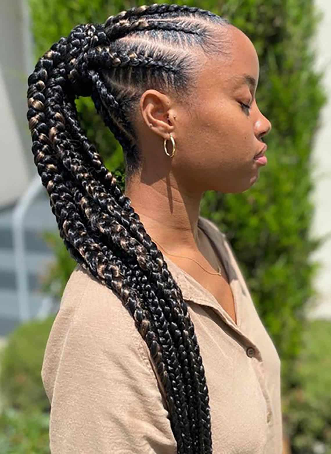 woman with cornrows in ponytail