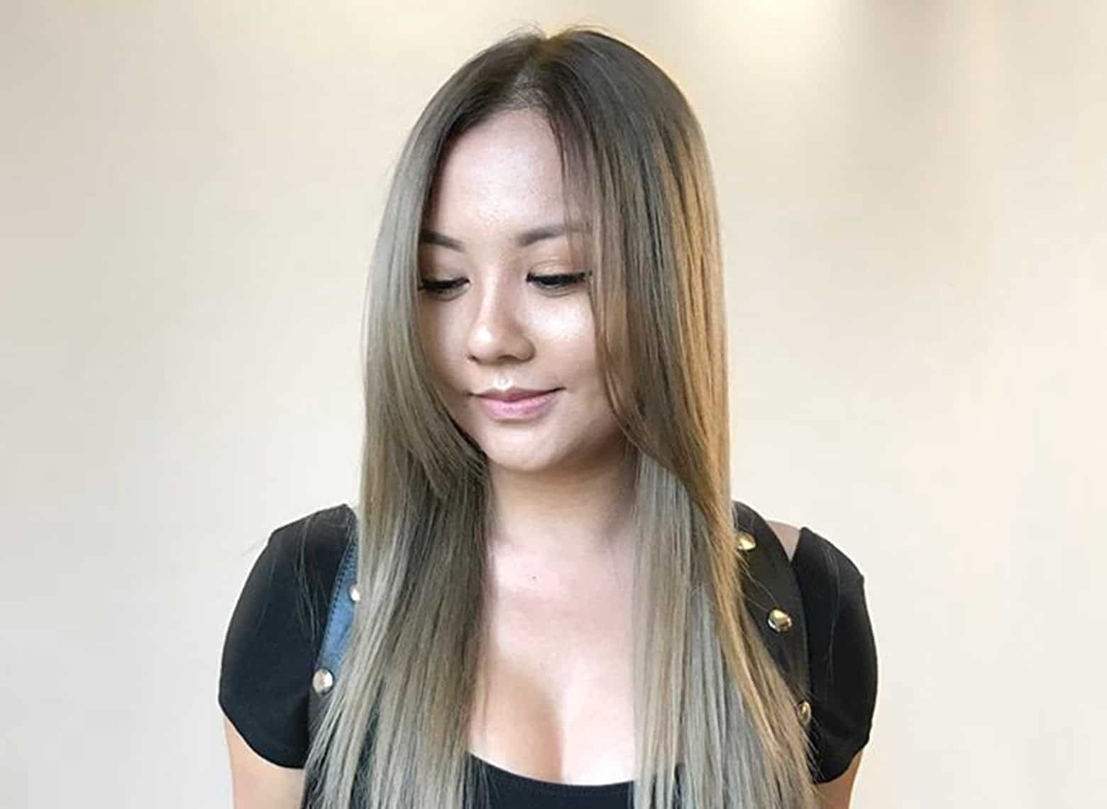 woman with straight hair and long bangs