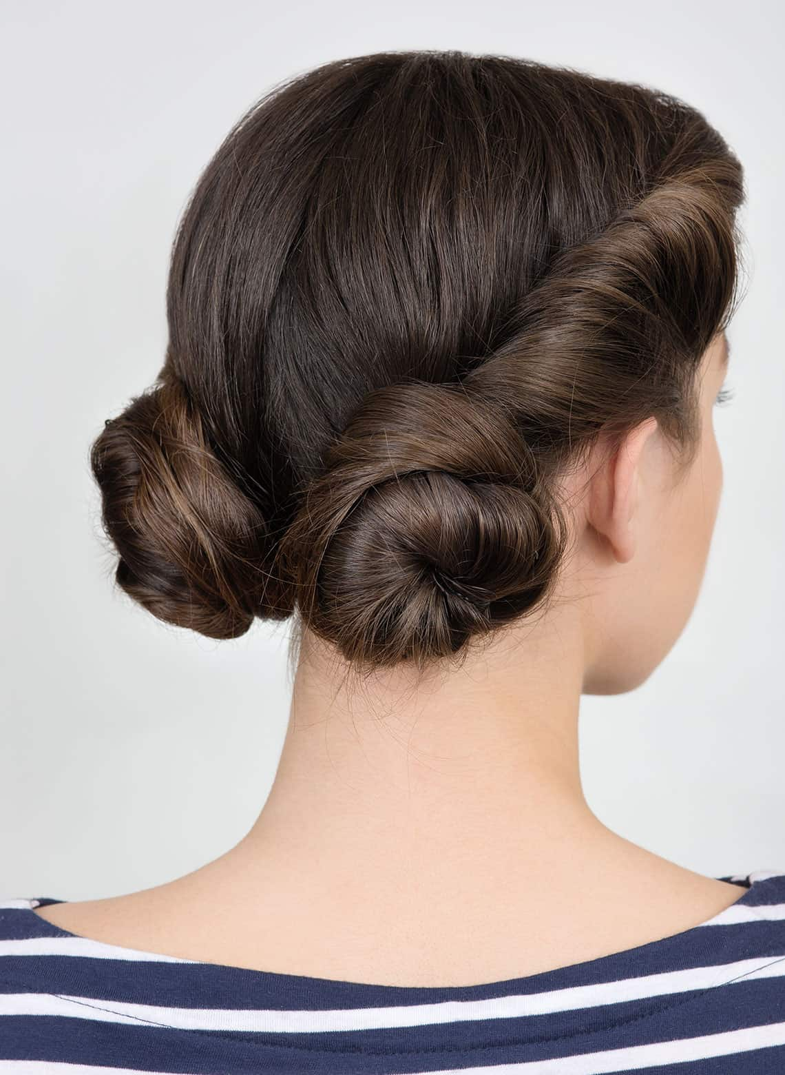 woman with low double buns