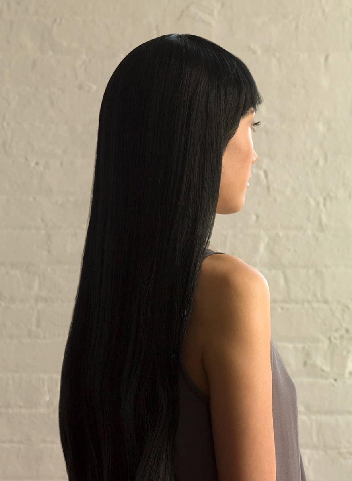 woman with sleek and straight hair