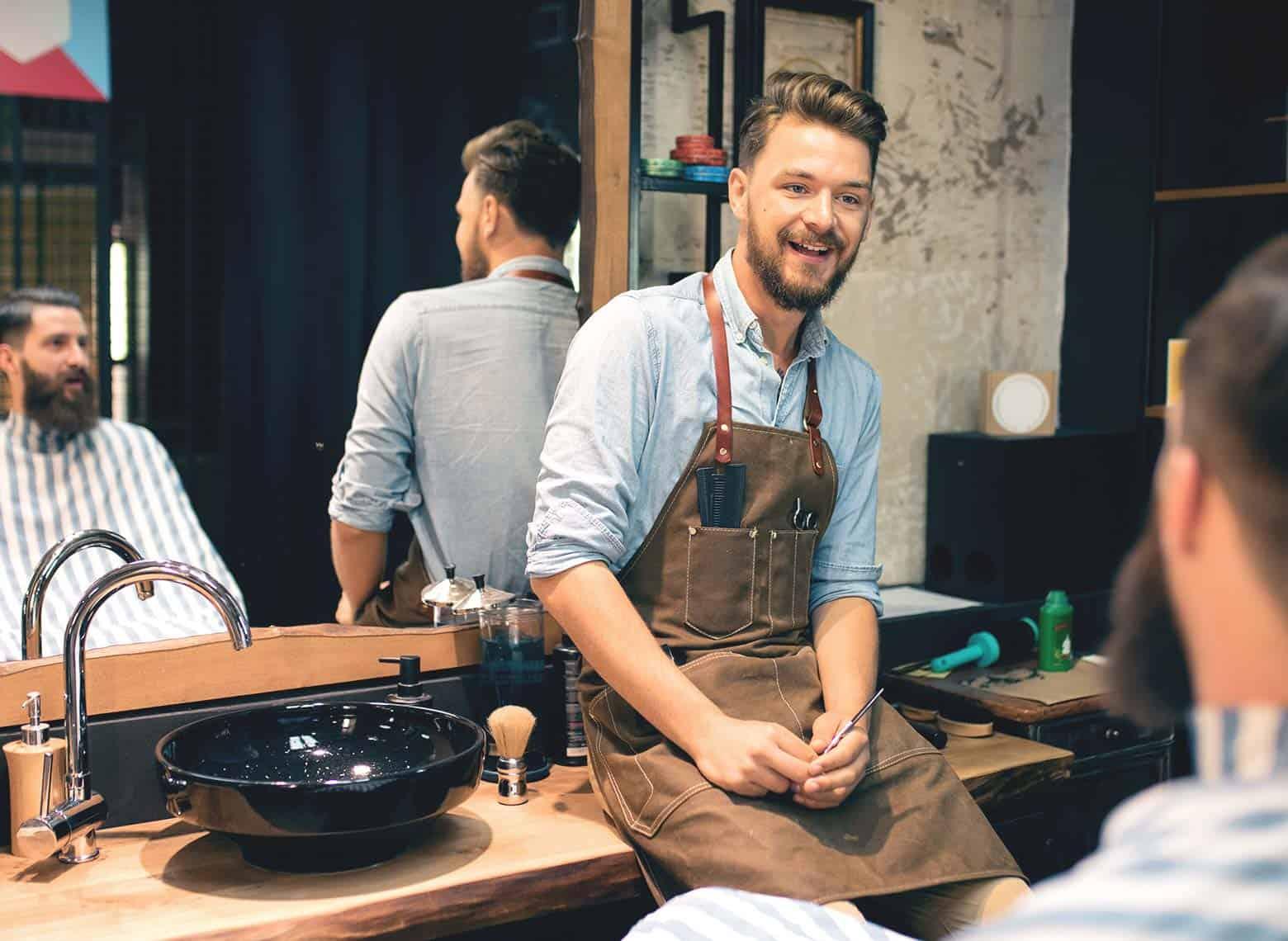 barber speaking to customer