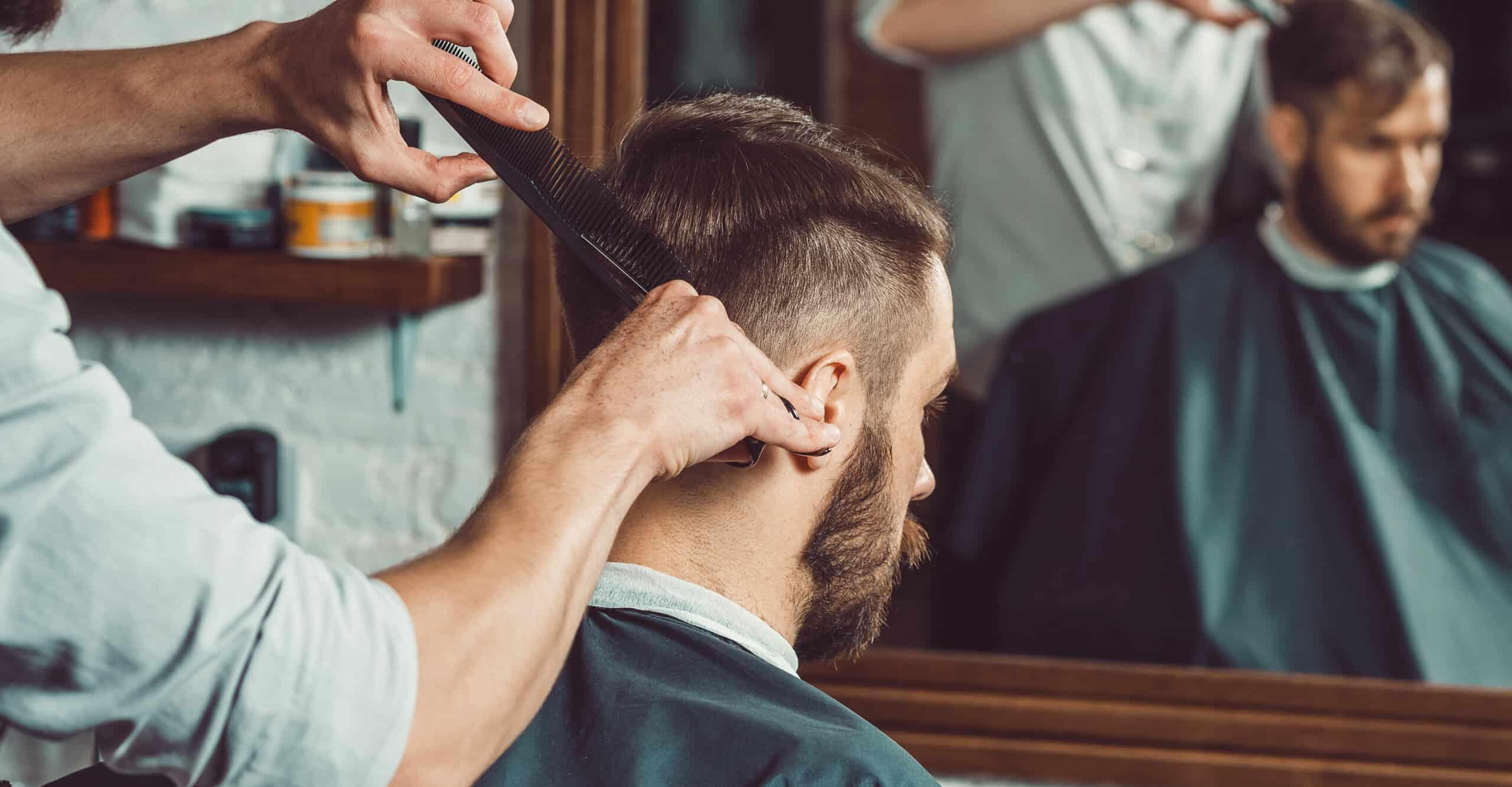 man getting haircut at a barber shop