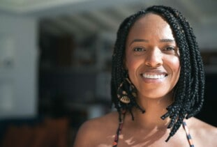 woman smiling with braided shoulder length hair