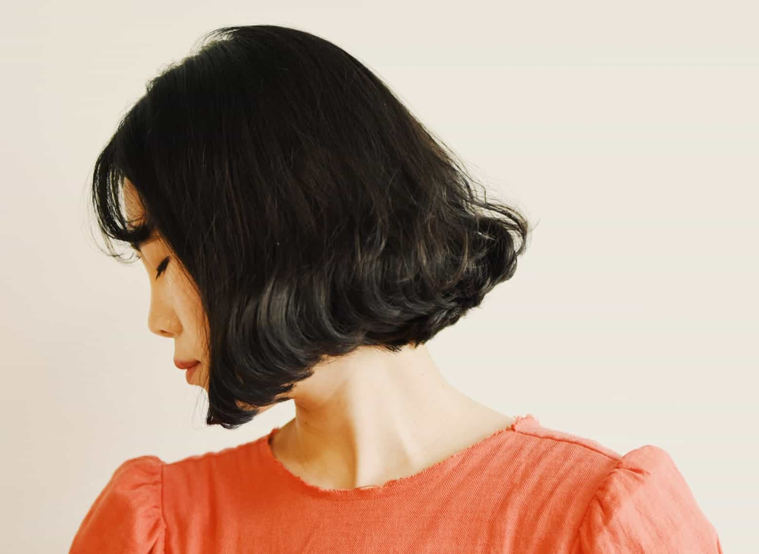 woman with curled in long bob