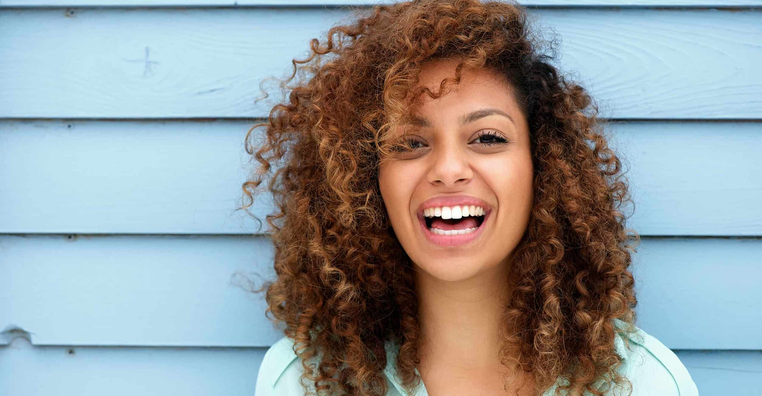 happy woman with curly hair