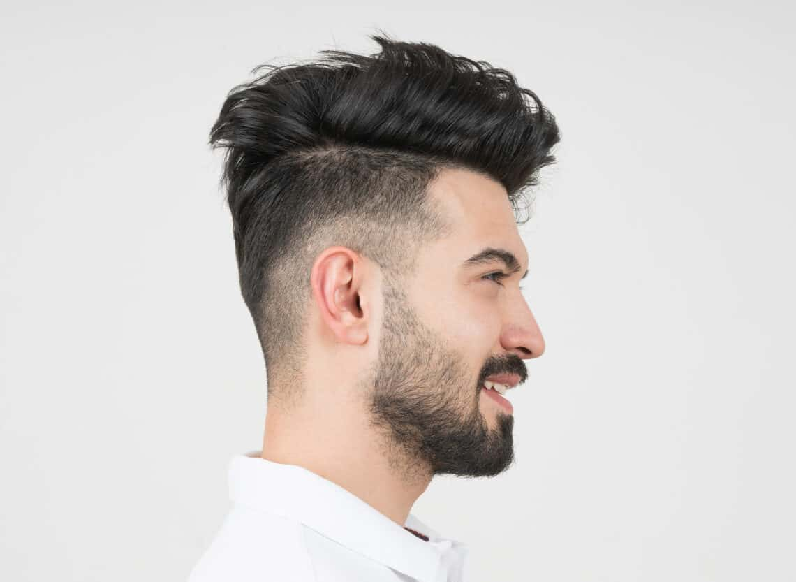 man with faux hawk fade